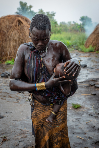 Mursi woman with child Ethiopia